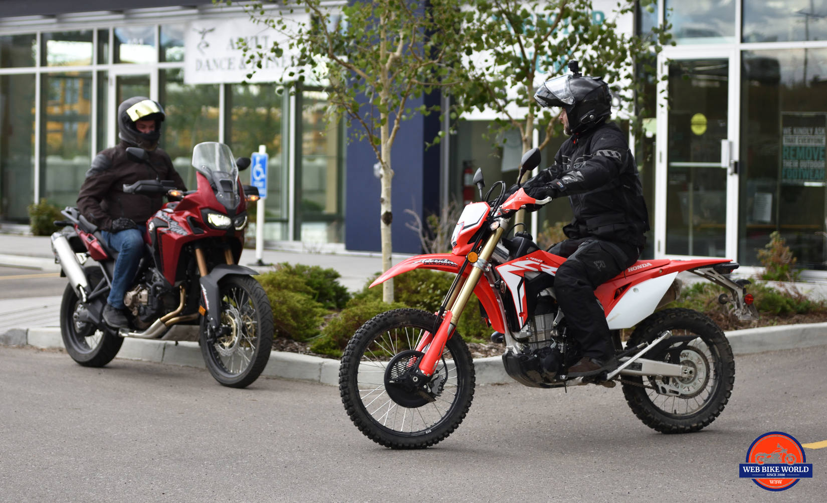 2019 Honda CRF450L and 2018 Honda Africa Twin looking on.