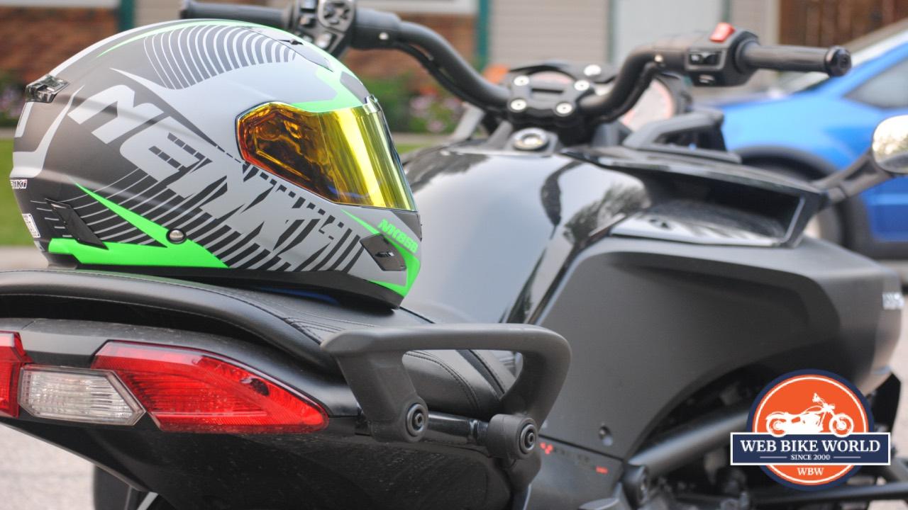 NENKI NK856 Helmet resting on Motorcycle
