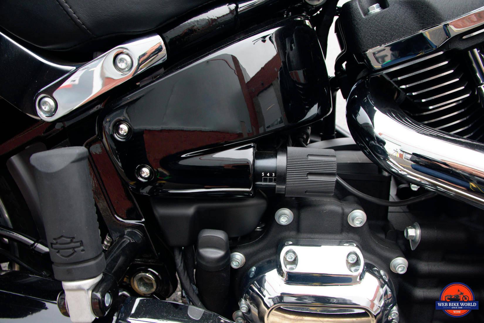 Rear suspension preload adjuster handle on a Sport Glide.