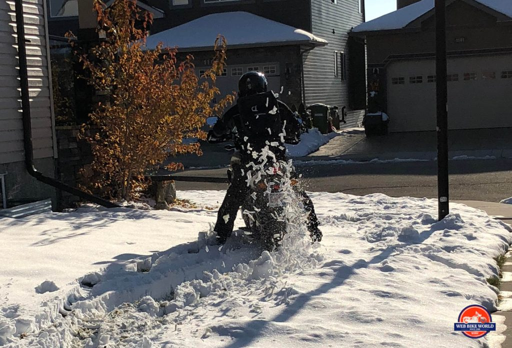 Me riding through the snow while wearing the Velomacchi 40L Speedway Backpack.