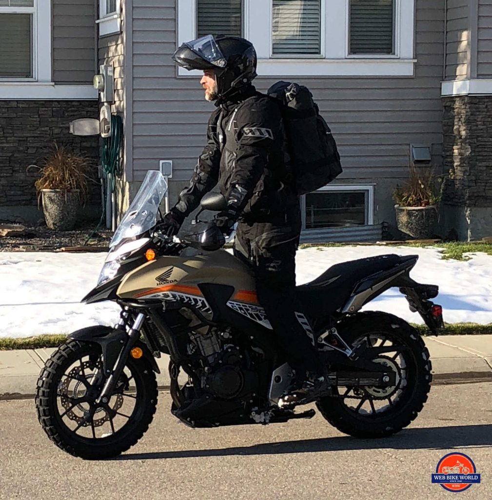 Me riding a Honda CB500X wearing a Velomacchi 40L Speedway Backpack.