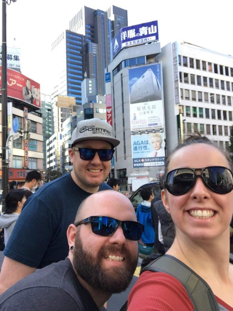 Brett (bottom), Jordan (right) and their friend Jeff (left) enjoying Japan after the competition