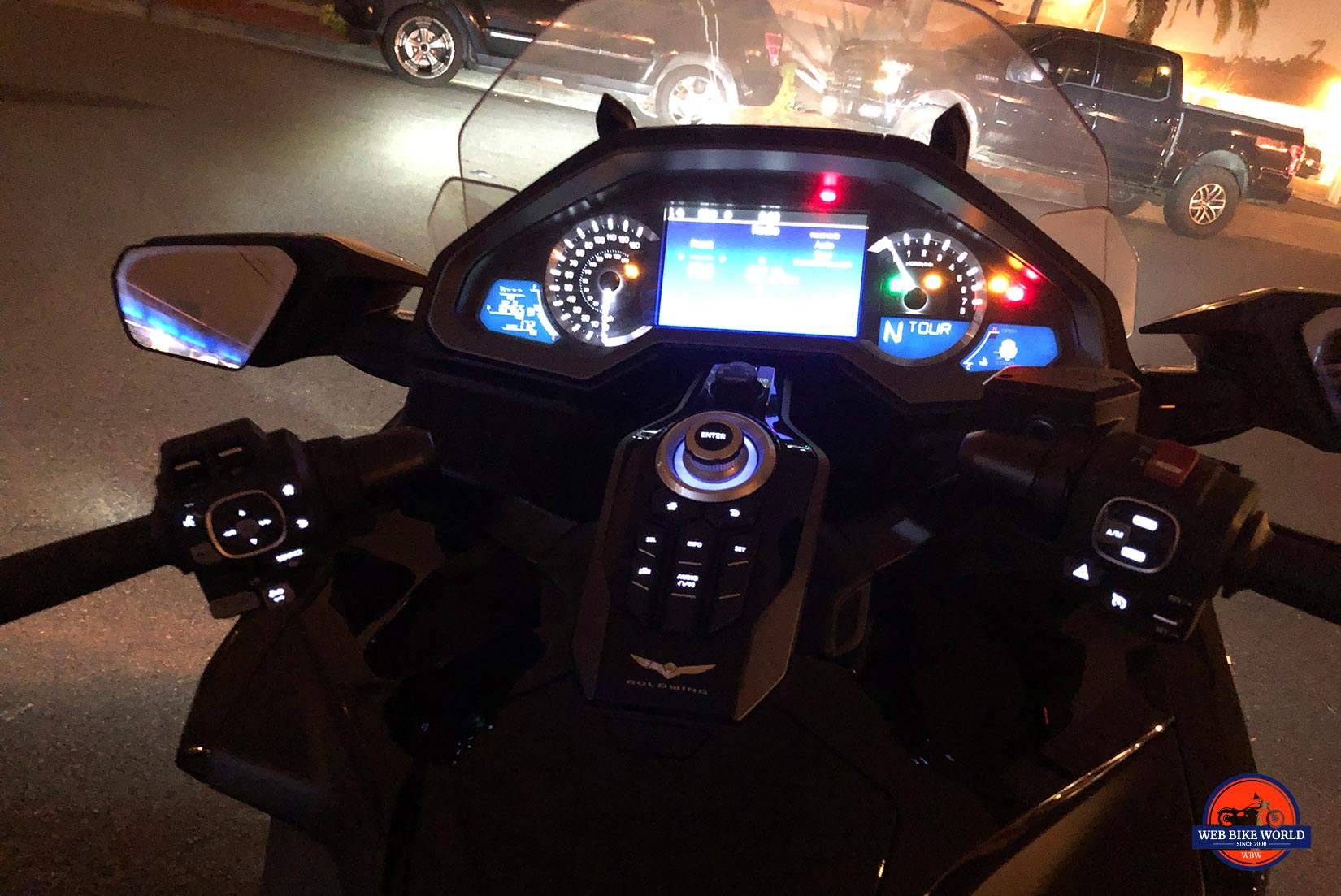Gold Wing DCT dash and handlebars at night.