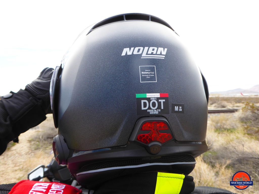Rear view of the Nolan N100-5 helmet with N-Com B901L and ESS light installed.