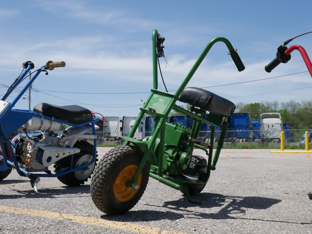 green minibike parked at pull start racing league event