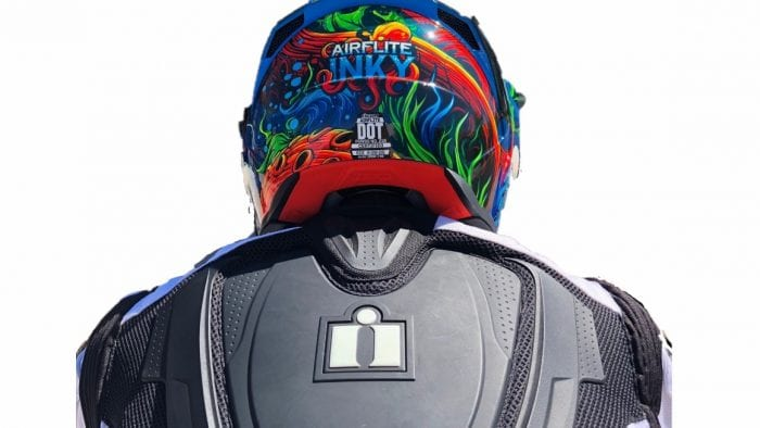 Icon Airflite Inky helmet rear view of helmet meeting jacket back protector