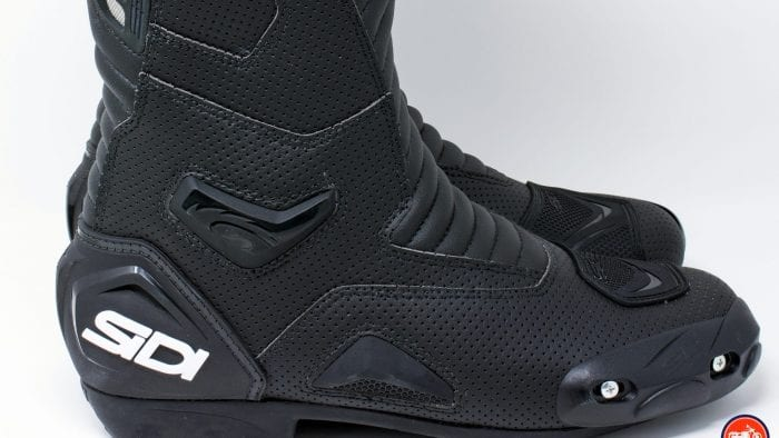 Close up view of tie sliders and outer ankle armor