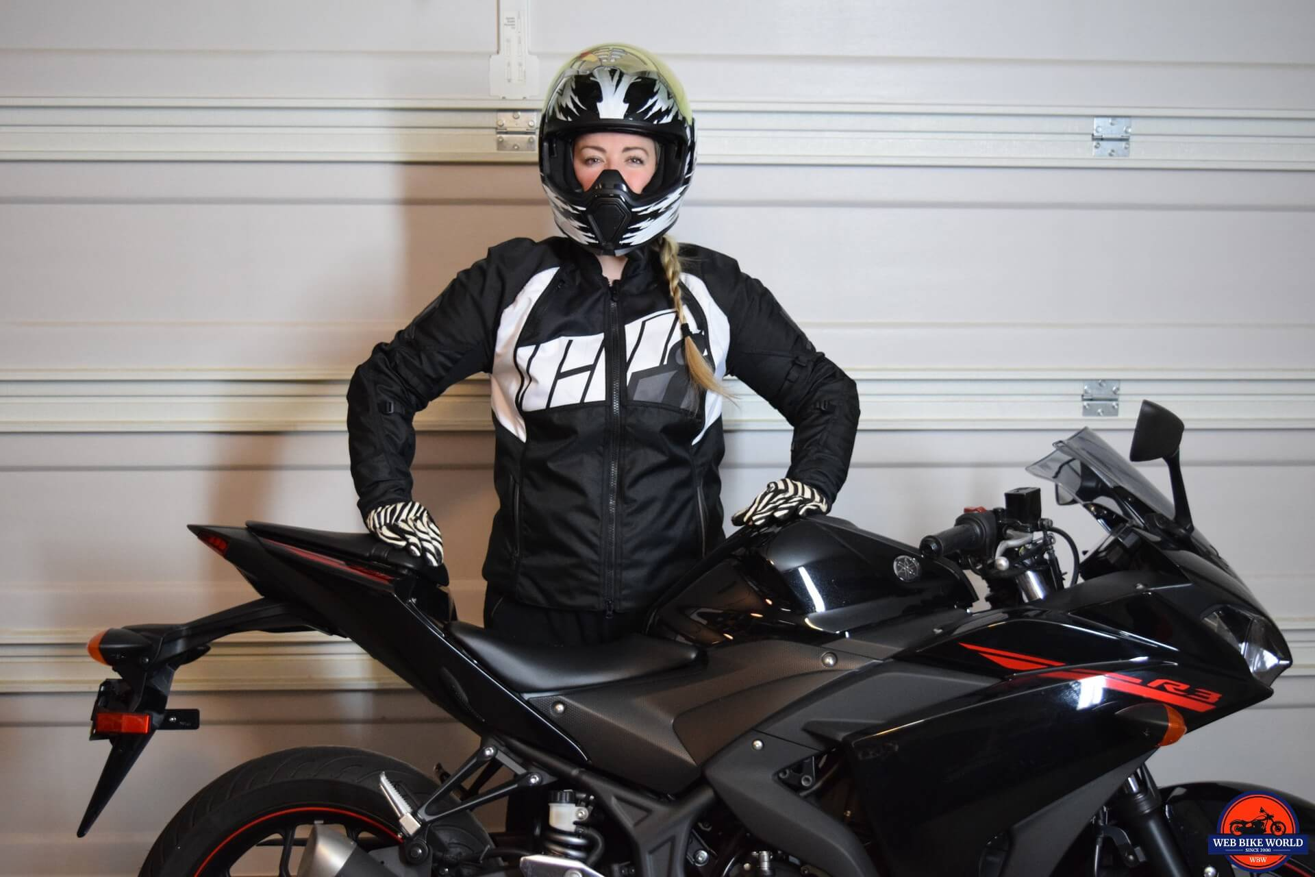ICON Women's Automag 2 Jacket worn by Brittany next to her motorcycle
