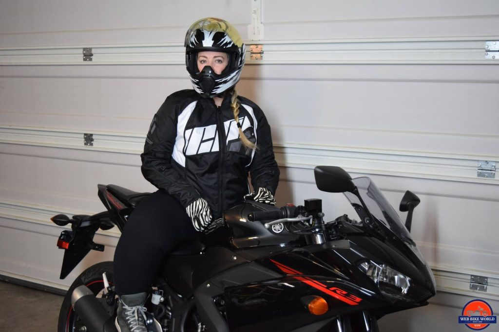 ICON Women's Automag 2 Jacket worn by Brittany while on motorcycle for full style look