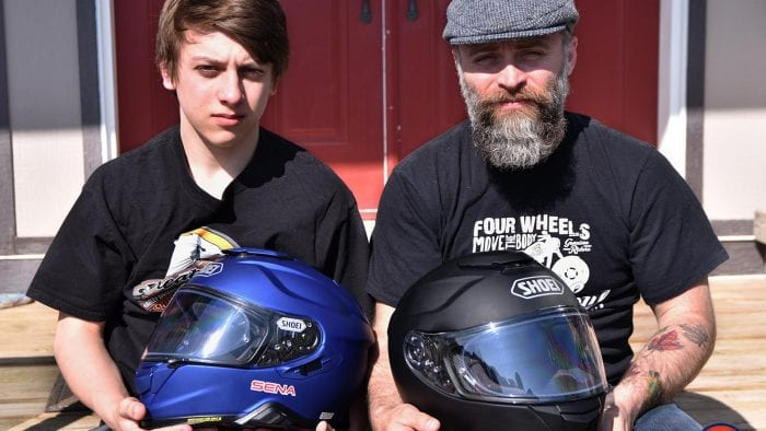 Father and son holding the Shoei GT Air and GT Air II helmets.