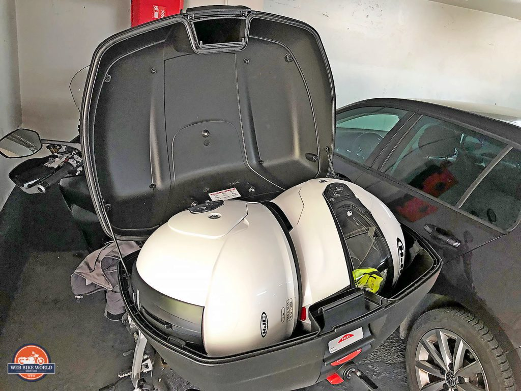 Trunk space on a 2019 Ducati Multistrada 1260S holding two full face helmets along with other gear.