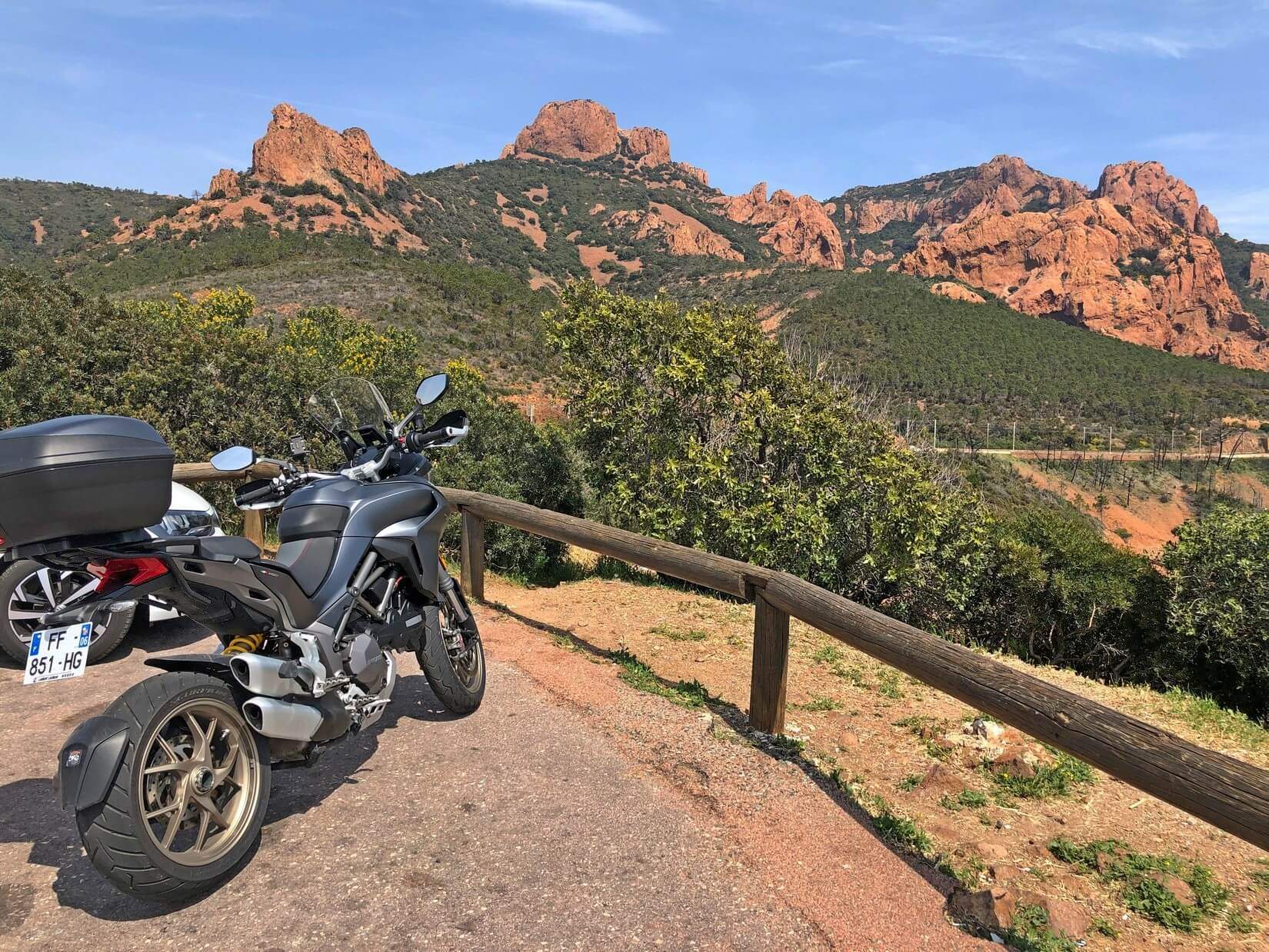 Red rocks in southern France with a Ducati Multistrada 1260S.