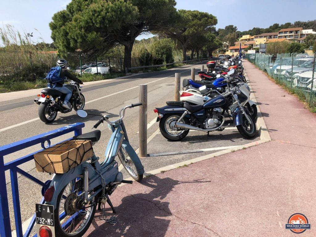Many motorcycles parked together in France.