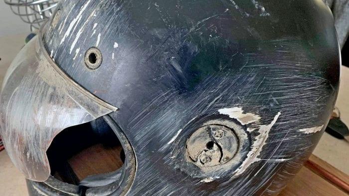 A Bell Bullitt helmet that has been crashed in.
