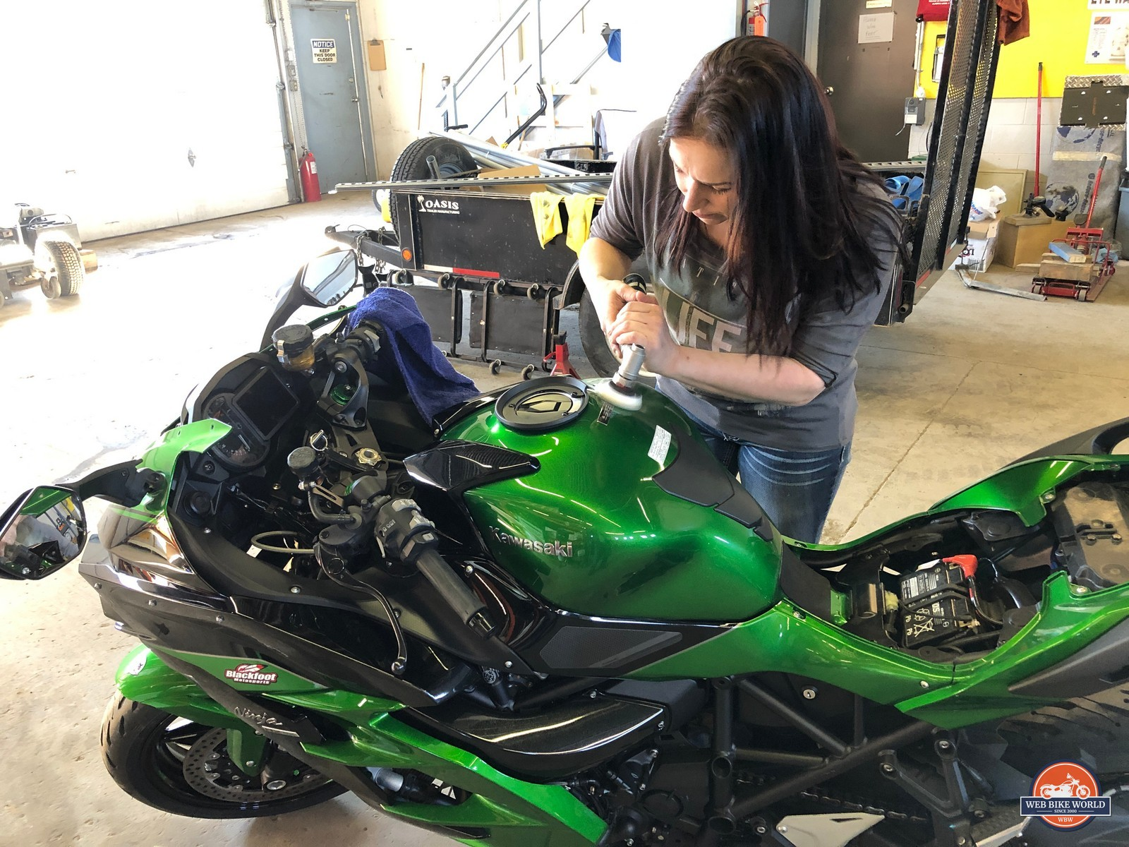 Kate polishing the paint on my Ninja.