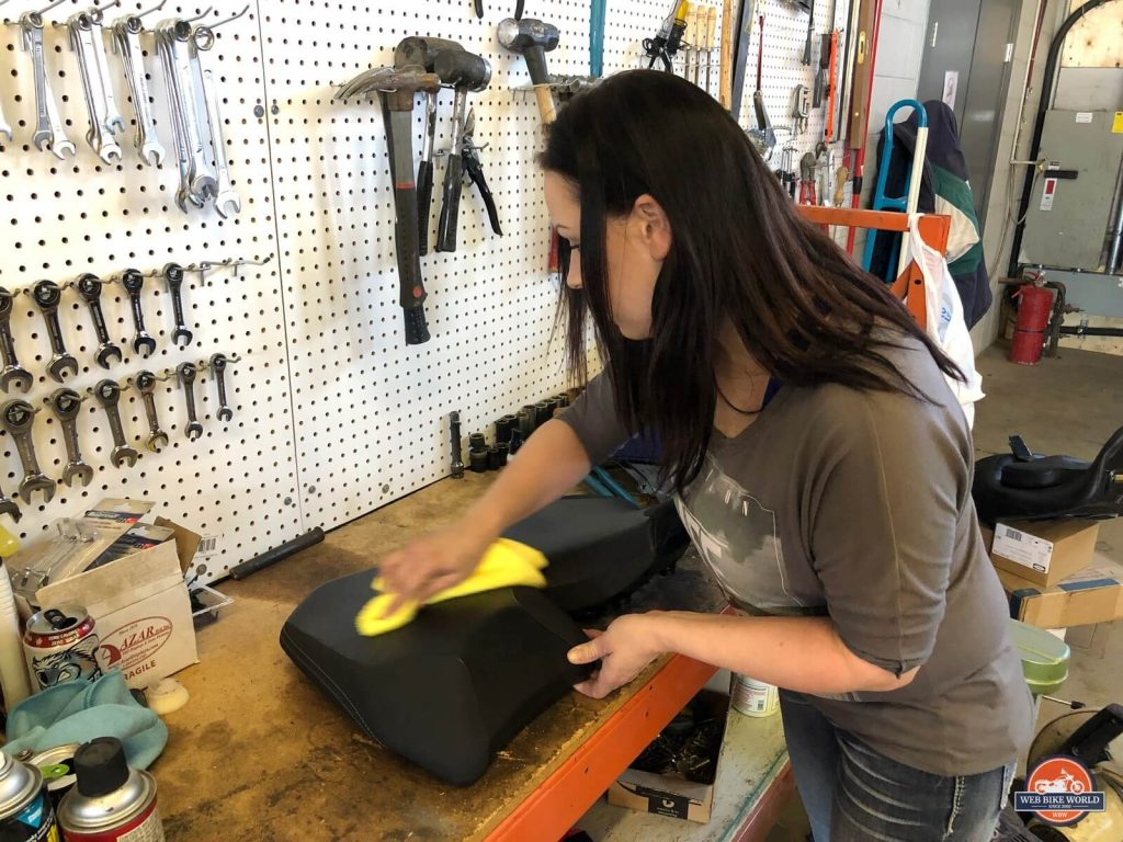 Kate coating my leather seat with Feynlab protection.