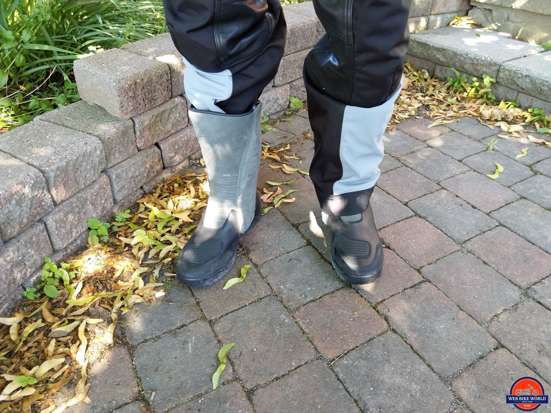 REV'IT! Gravel OutDry Boots with one pant leg tucked in and other covering boot