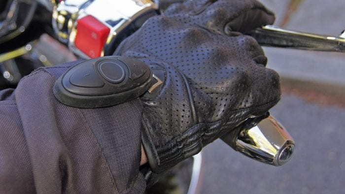 Sena SC1M remote attached to moto glove