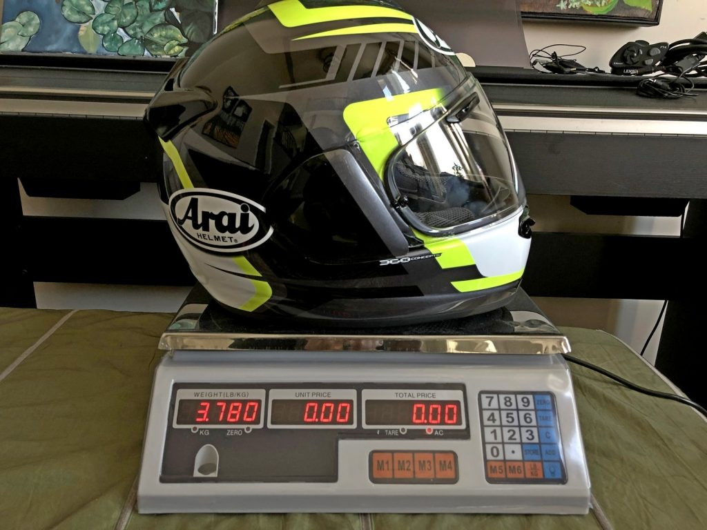 A Snell approved Arai DTX helmet on a scale.