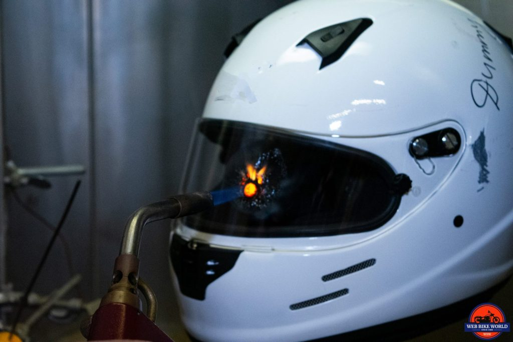 Using a torch on a helmet visor at the Snell laboratory.