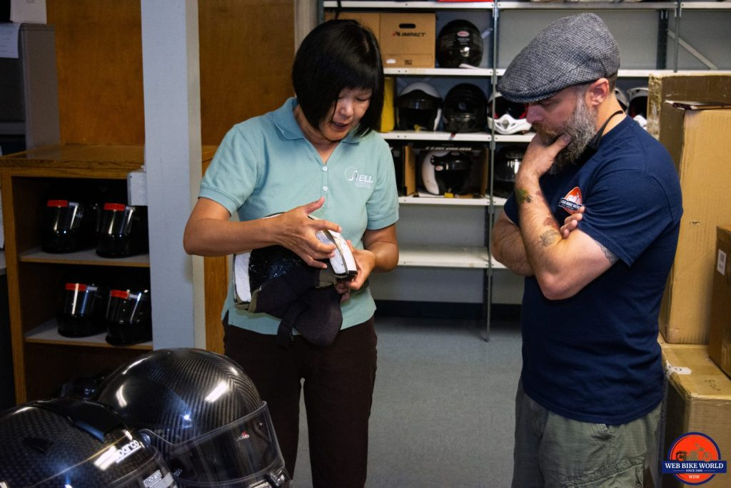 Hong Zhang shows me collapsed EPS foam in a cutaway model of a helmet.