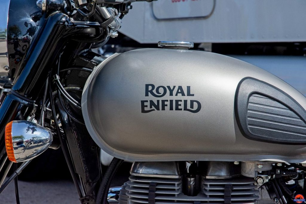 The Royal Enfield brand name painted on a gas tank.