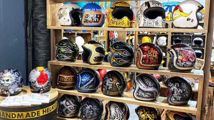 A collection of custom helmets from EICMA 2019 displays.