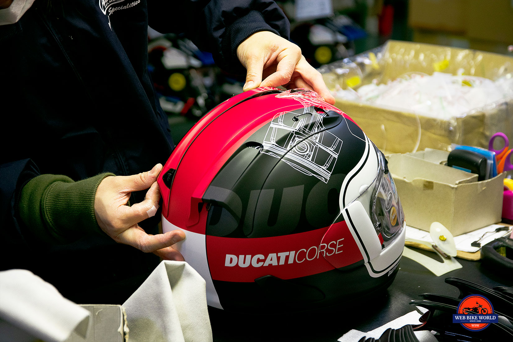 Putting the final touches on a Arai helmet.