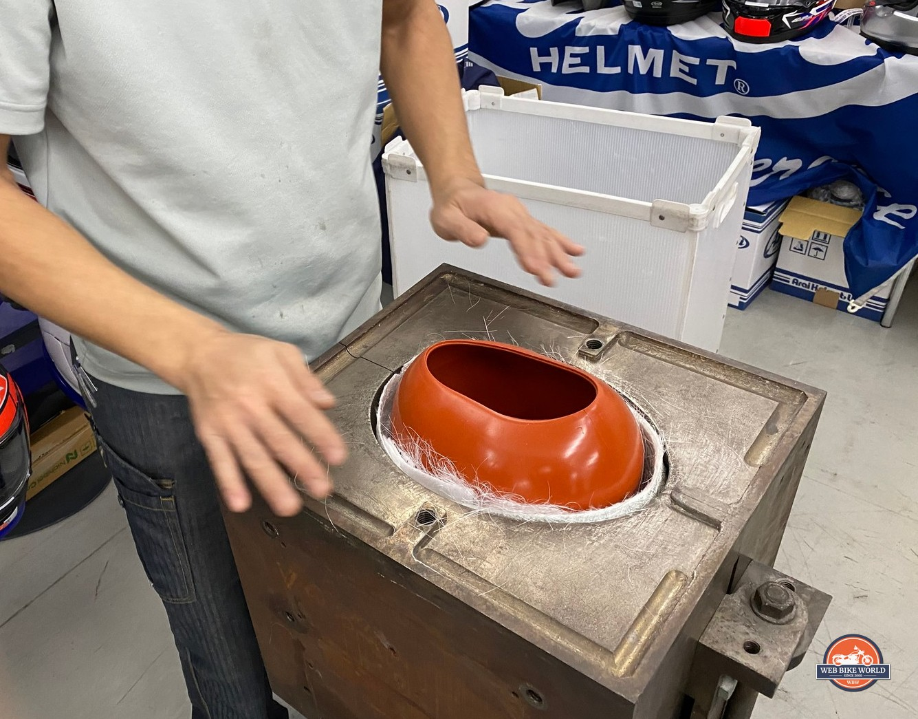 A balloon placed inside the helmet shell mold ready to be inflated to crush the materials together while it cures.