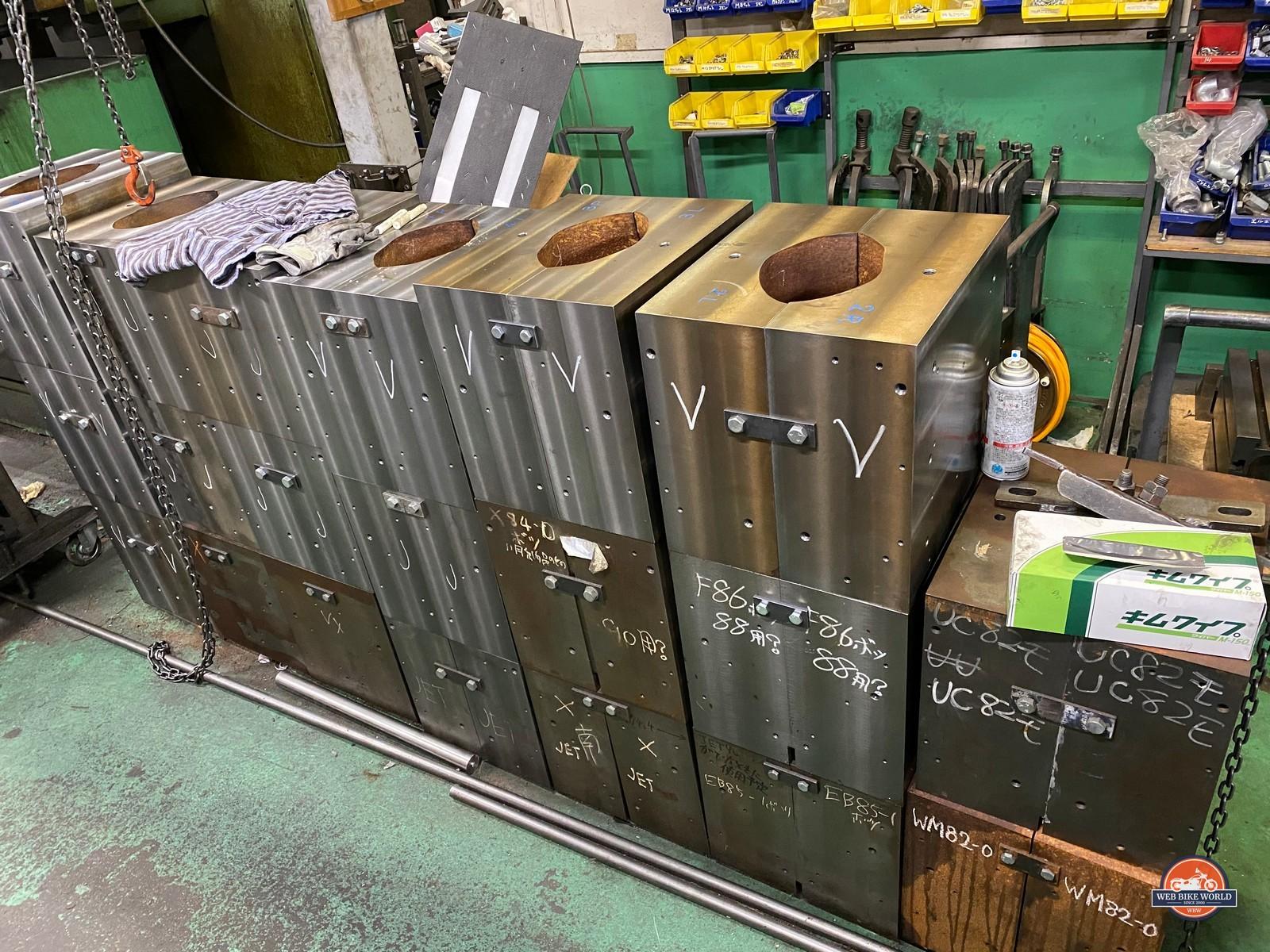 Several steel molds used to build fiberglass helmet shells at the Arai factory.