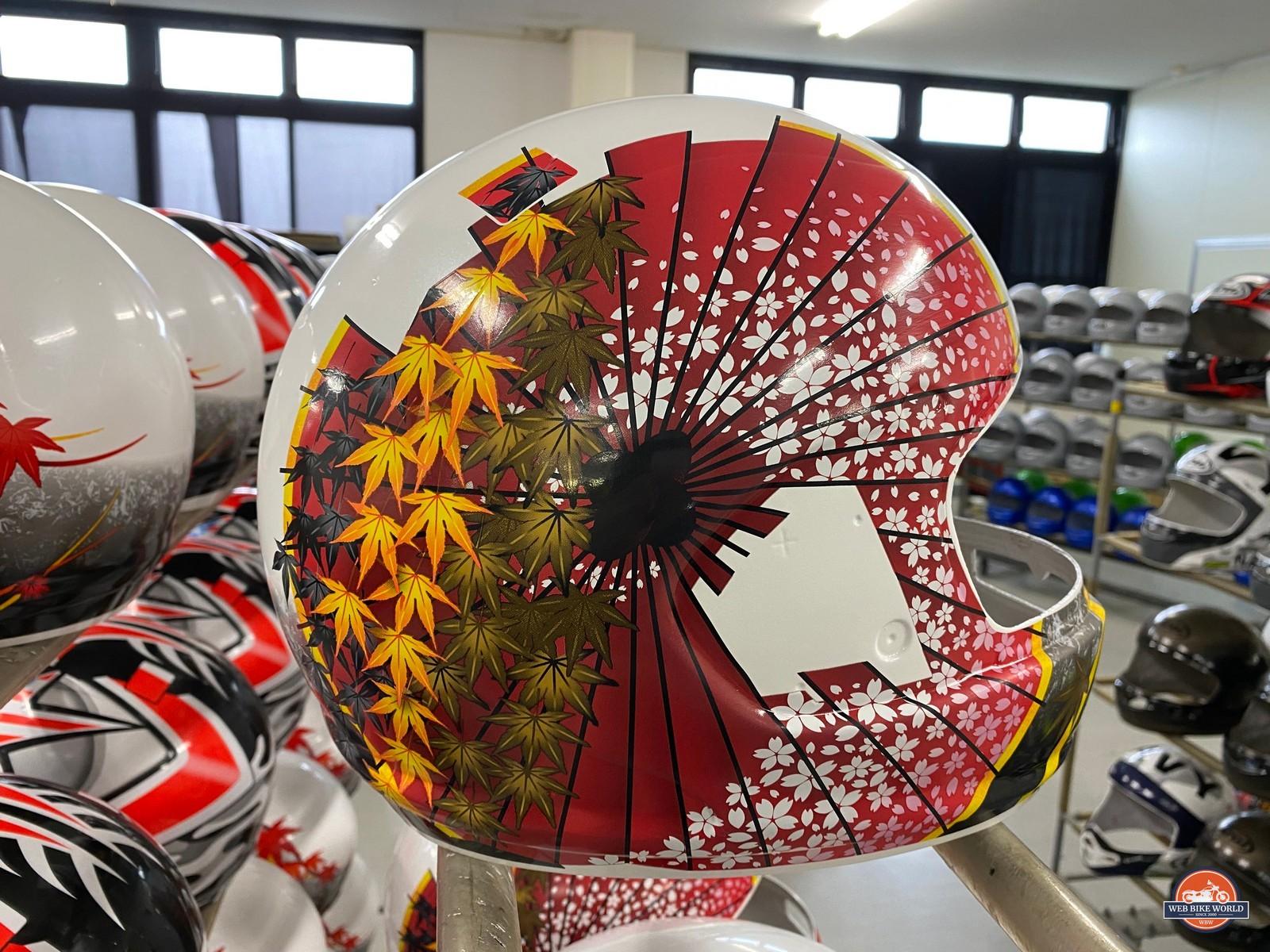 Japanese maple leaf decals on an Arai helmet.