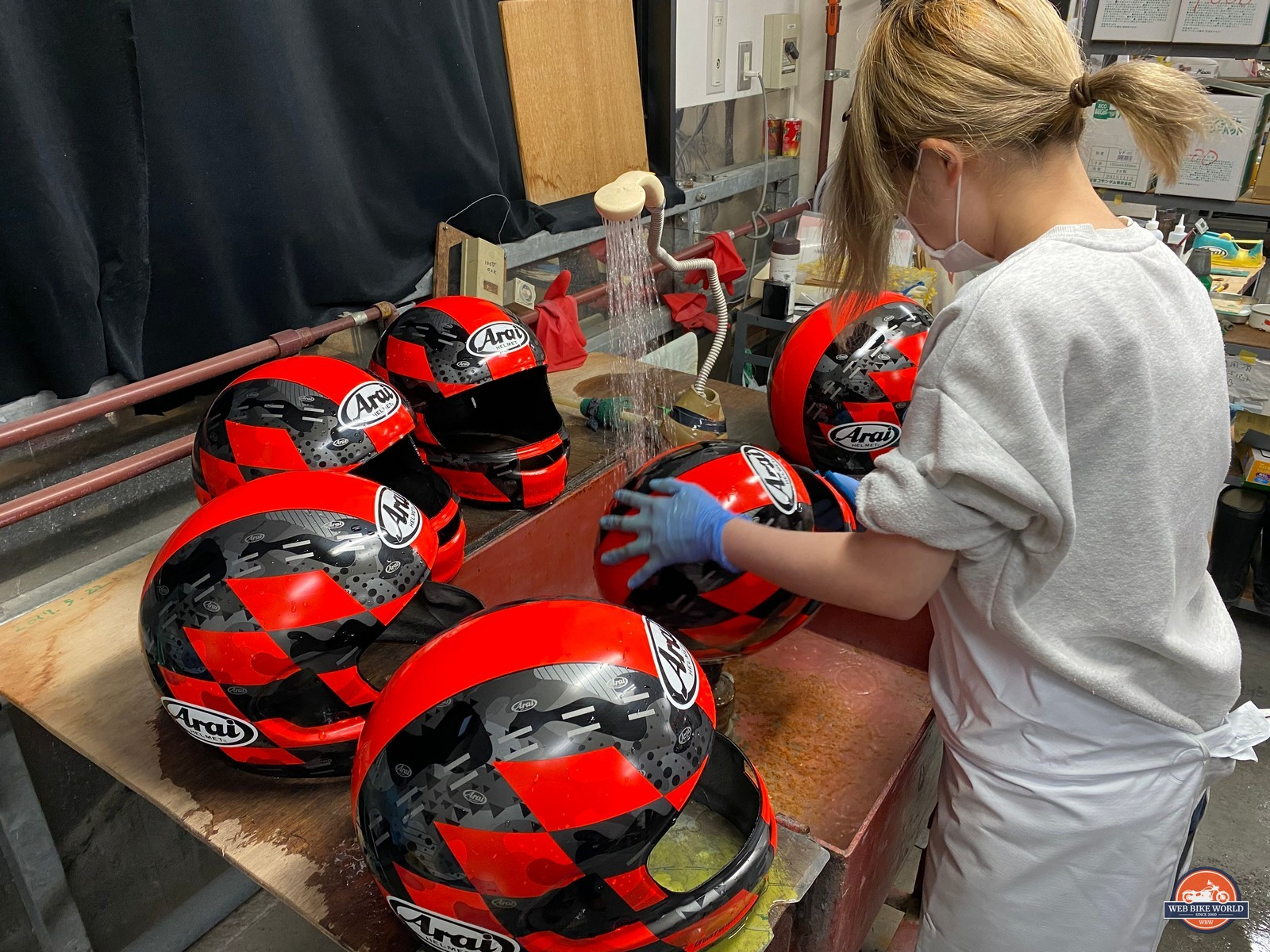 Washing new helmet shells at the Arai helmet factory.