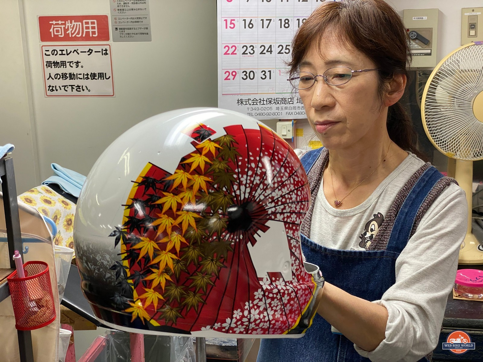 Applying decals to helmets at the Arai factory.