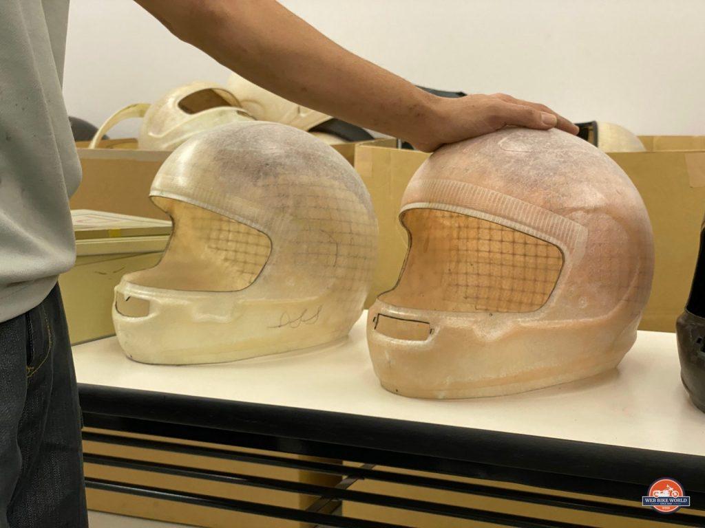 The lastest two versions of the modern Arai helmet shells.