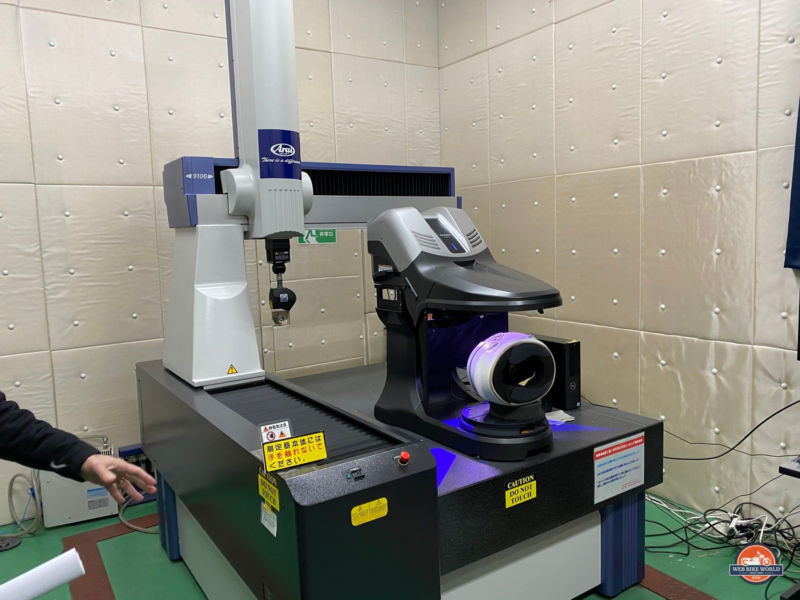 The new 3D scanner for helmet shells sits on top of the retired older 3D scanner at the Arai factory.