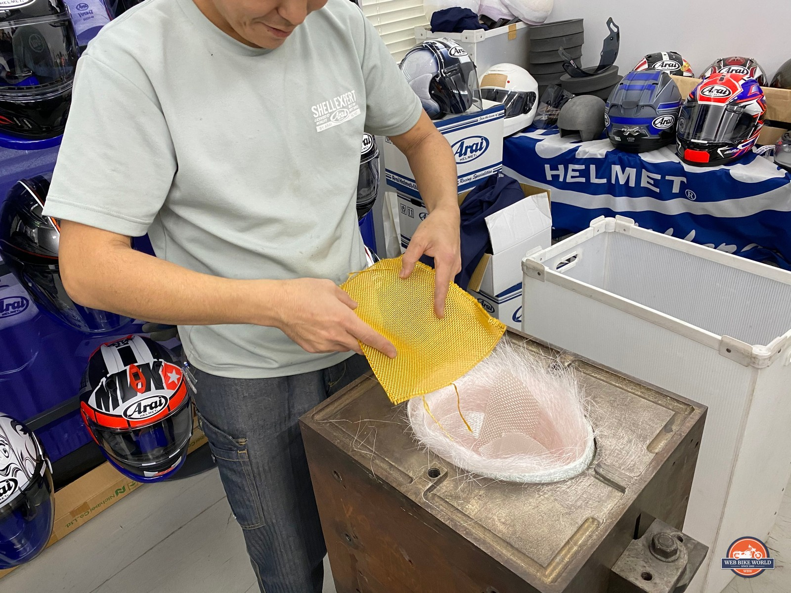 The Arai shell expert carefully adds each piece of the puzzle to the mold in the correct order.