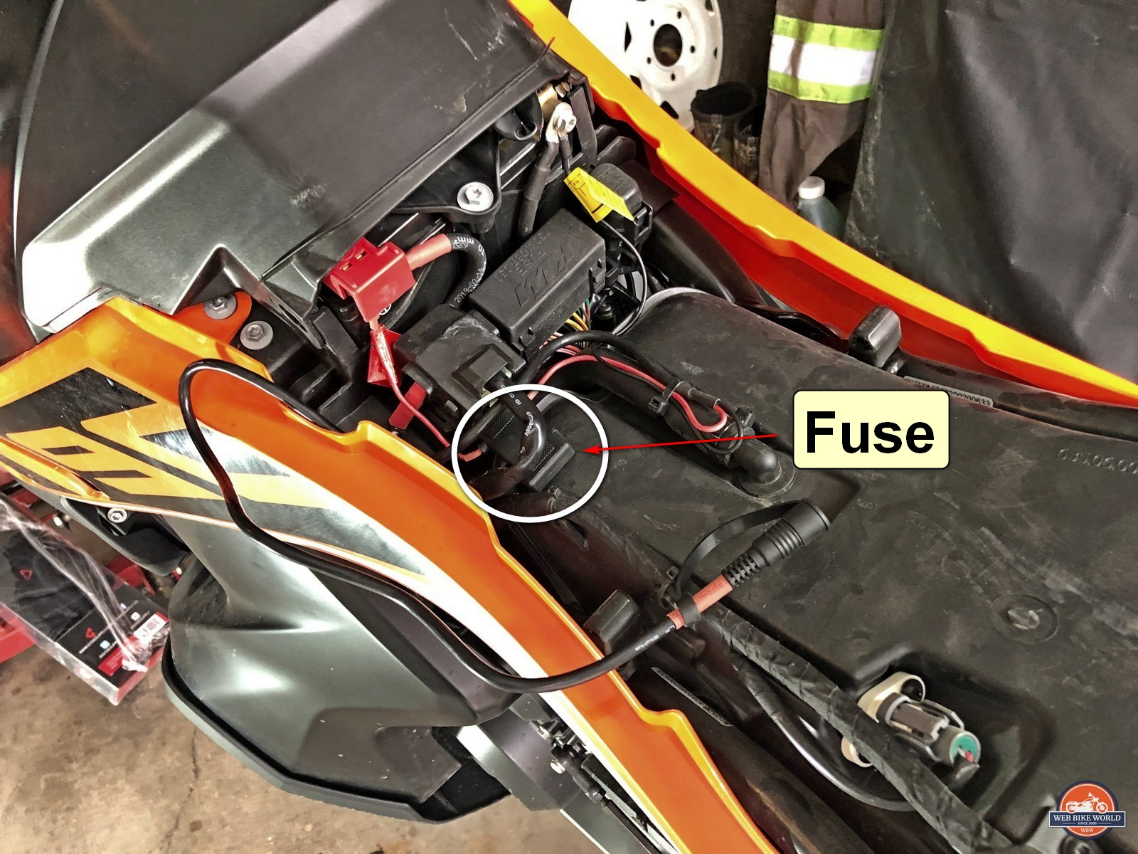 Close up showing the inline fuse holder in the power harness for the Gerbing heated vest.