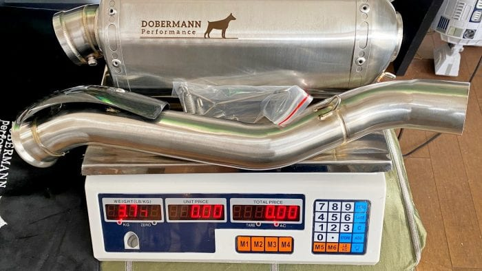 The Dobermann Performance exhaust for a 790 Adventure on a scale
