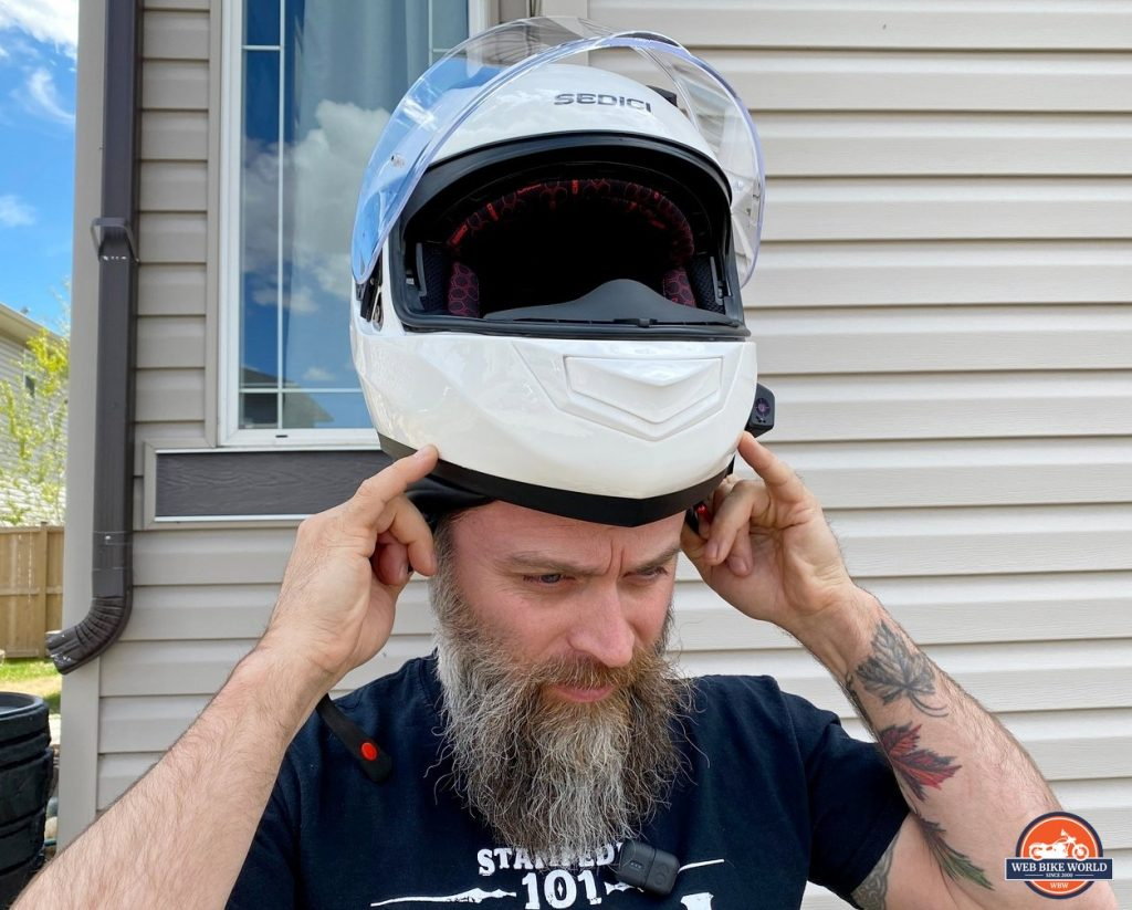 Donning the Sedici Strada II helmet.