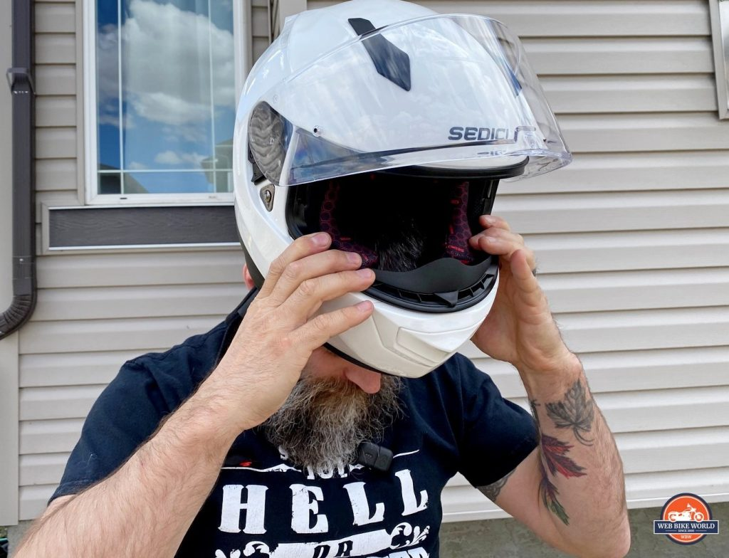 Donning the Sedici Strada II helmet