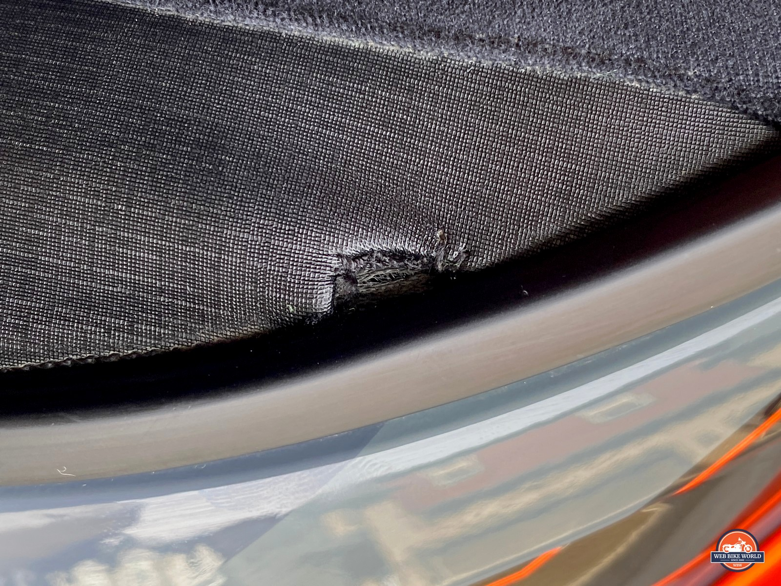A blemish on the neckroll of the Klim Krios Pro helmet.