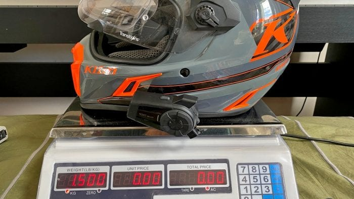 The Klim Krios Pro with a Sena 10 EVO installed on it being weighed.