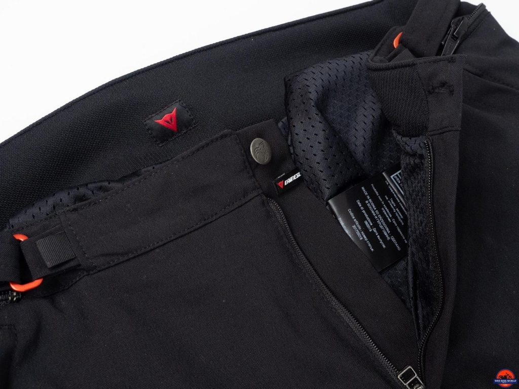 Zipper and button unfastened showing interior lining