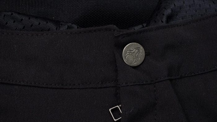 Closeup of main button after replacement with one I had on hand from other riding pants