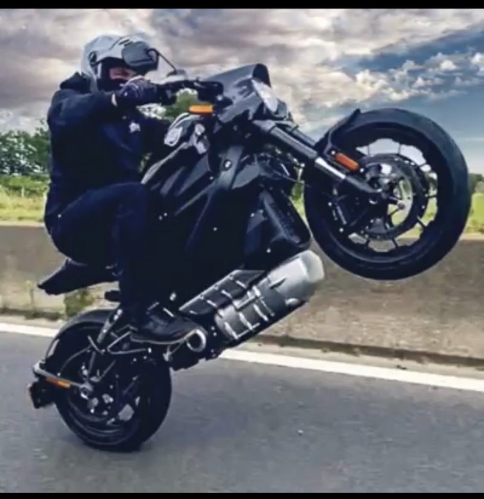 A rider doing a wheelie with the LiveWire