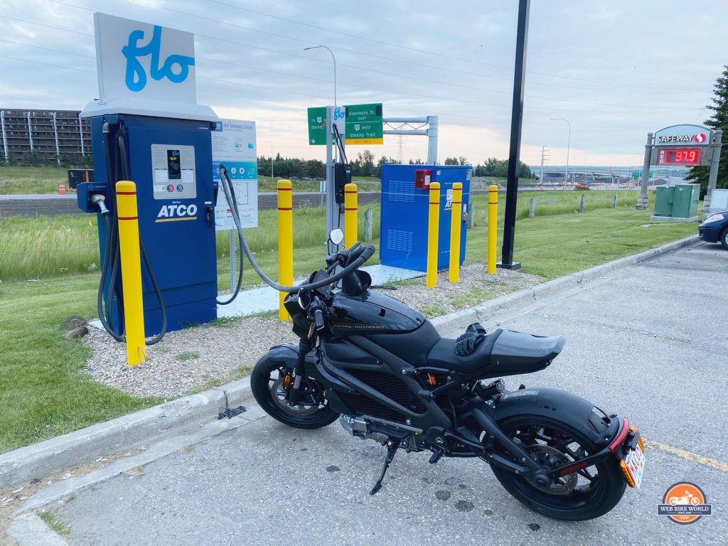 The Harley Davidson LiveWire charging at a fast charge station.