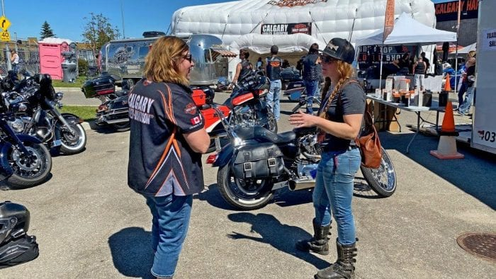 People enjoying the festivities of the Rally in the Rockies held at Calgary Harley Davidson.