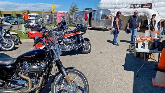 Motorcycles parked at the Calgary Harley Davidson parking lot.