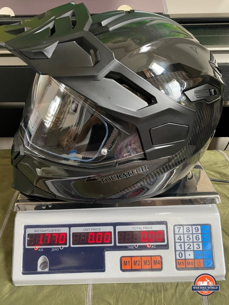 The Touratech Aventuro Traveller Carbon helmet on a scale (in kg)