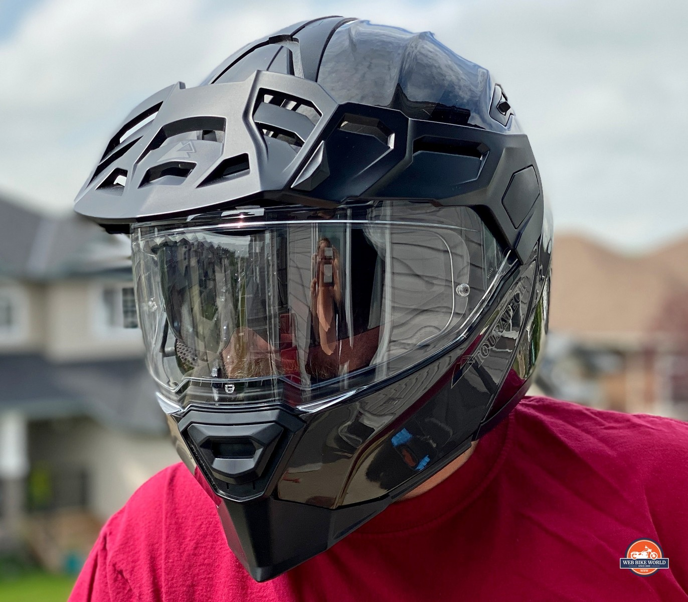 Angle view of the Touratech Aventuro Traveller Carbon helmet.